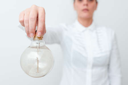 Lady Holding Lamp Upside Down In Shirt Presenting New Ideas For Project, Business Woman Carrying Bulb Opposite Showing Late Technologies, Vise Versa Lightbulbs Exhibiting Fresh Opinion