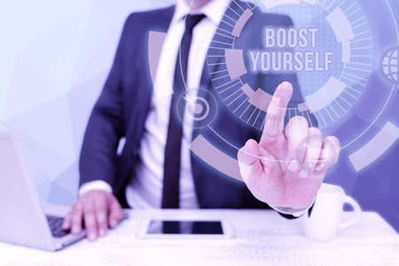Conceptual display Boost Yourself. Internet Concept delivering a lift up to someone making them energetic again Bussiness Man Sitting Desk Laptop And Phone Pointing Futuristic Technology. Reklamní fotografie