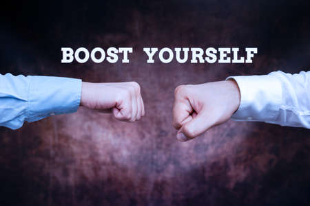 Text sign showing Boost Yourself. Internet Concept delivering a lift up to someone making them energetic again Two Professional Well-Dressed Corporate Businessmen Handshake Indoors