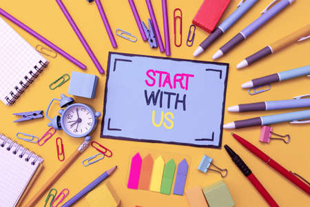 Handwriting text Start With Us. Word for inviting someone to work together for certain job or target Flashy School And Office Supplies Bright Teaching And Learning Collections Reklamní fotografie