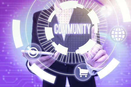 Writing displaying text Community. Business overview group of showing with a common characteristics living together Lady In Uniform Holding Phone Pressing Virtual Button Futuristic Technology.
