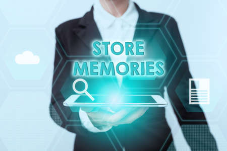 Conceptual caption Store Memories. Conceptual photo a process of inputting and storing data previously acquired Woman In Suit Standing Using Device Showing New Futuristic Virtual Tech. Stock Photo