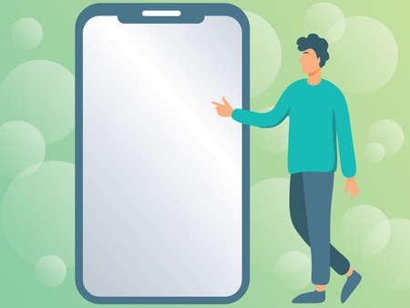 Man Drawing Standing Next To A Large Phone Pointing Out New Technologies. Gentleman Points Fingers Towards Big Device Screen Showing Fresh Technology.