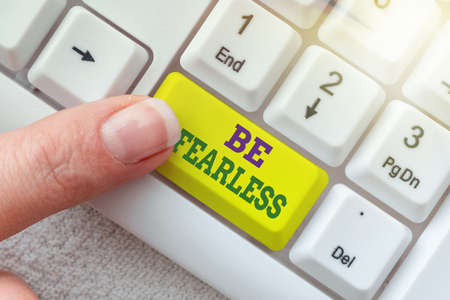 Text caption presenting Be Fearless. Word for act of striving to lead an extraordinary life and make a difference Typing Cooking Lesson Guidebook, Retyping New Online Guidelines Imagens