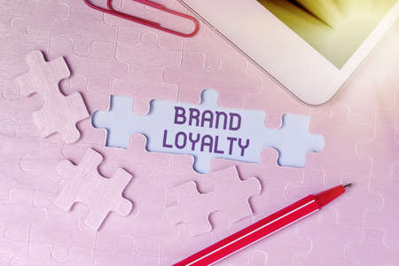 Conceptual display Brand Loyalty. Business approach positive feelings to a brand and purchase the same product Building An Unfinished White Jigsaw Pattern Puzzle With Missing Last Piece Stockfoto