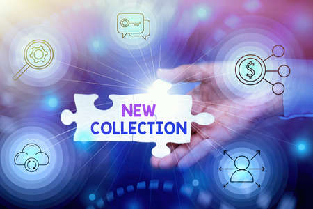 Text sign showing New Collection. Business idea contain a set of freshlydesigned clothes to be released soon Hand Holding Jigsaw Puzzle Piece Unlocking New Futuristic Technologies.