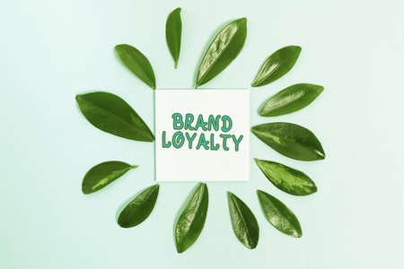 Hand writing sign Brand Loyalty. Business overview positive feelings to a brand and purchase the same product Creating Nature Theme Blog Content, Preventing Environmental Loss