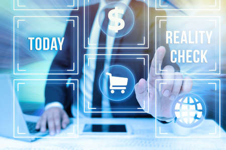 Text sign showing Reality Check. Business overview making the an individual recognize the real state of the situation Bussiness Man Sitting Desk Laptop And Phone Pointing Futuristic Technology.