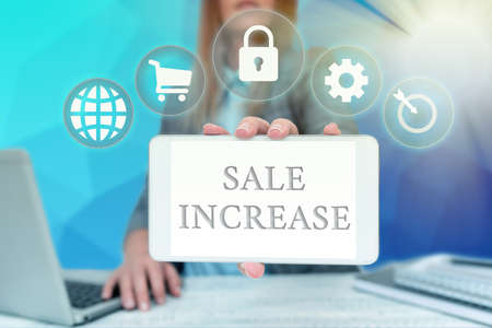 Inspiration showing sign Sale Increase. Business idea Average Sales Volume has Grown Boost Income from Leads Business Woman Sitting In Office Holding Mobile Displaying Futuristic Ideas. Stock Photo