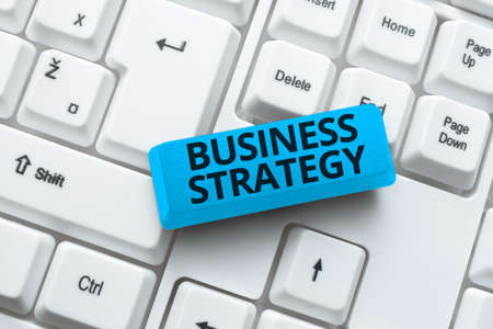 Conceptual caption Business Strategy. Business approach working plan of a business for achieving its vision Writing Comments On A Social Media Post, Typing Interesting New Article Фото со стока