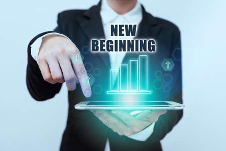 Conceptual caption New Beginning. Business concept Different Career or endeavor Starting again Startup Renew Lady In Suit Pointing On Tablet Showing Futuristic Graphic Interface. Foto de archivo