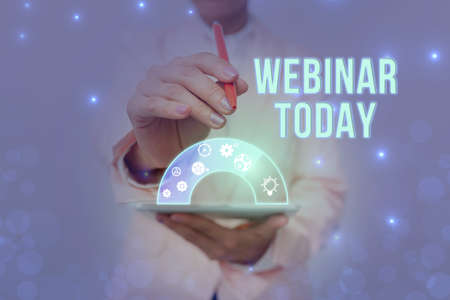 Hand writing sign Webinar Today. Business showcase live online educational presentation on different location Lady In Uniform Holding Pen Phone Showing Futuristic Virtual Interface. Stock fotó
