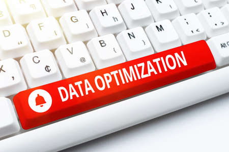 Writing displaying text Data Optimization. Word for process that prepares the logical schema from data view Entering Image Keyword And Description, Typing Word Definition And Meaning Stock Photo