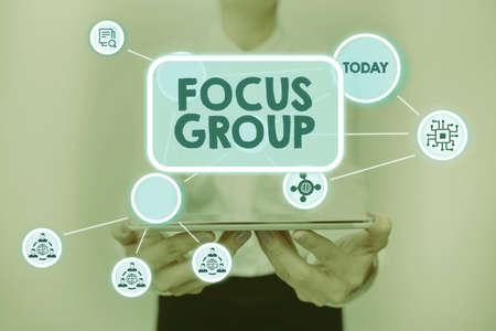 Sign displaying Focus Group. Business approach consist of carefullyselected participants to provide feedback Lady In Uniform Standing Holding Tablet Showing Futuristic Technologies. Фото со стока