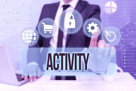 Handwriting text Activity. Concept meaning the condition where many things are happening or move around Bussiness Man Sitting Desk Laptop And Phone Pointing Futuristic Technology. Stock Photo