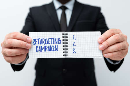 Hand writing sign Retargeting Campaign. Business concept targetconsumers based on their previous Internet action Presenting New Plans And Ideas Demonstrating Planning Process Stock Photo