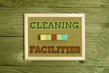 Text caption presenting Cleaning Facilities. Word Written on Place or equipment provided for a cleaning purposes Stack of Sample Cube Rectangular Boxes On Surface Polished With Multi-Colour Banco de Imagens