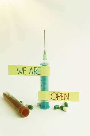 Text caption presenting We Are Open. Business approach no enclosing or confining barrier, accessible on all sides Writing Important Medical Notes Laboratory Testing Of New Infections