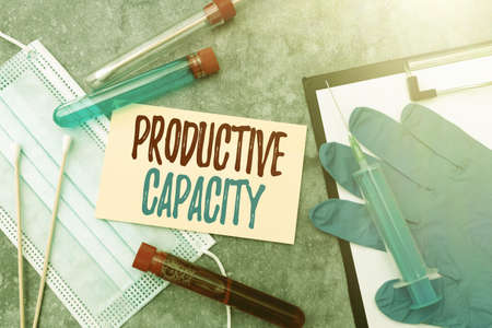 Text sign showing Productive Capacity. Business showcase the maximum possible output of a production plant Researching Preventive Medications, Viral Infection Prevention