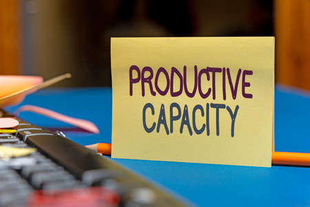 Writing displaying text Productive Capacity. Internet Concept the maximum possible output of a production plant Multiple Assorted Collection Office Stationery Photo Placed Over Table