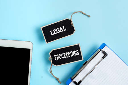 Inspiration showing sign Legal Proceedings. Word for procedure instituted in a court of law to acquire benefit Collection of Blank Empty Sticker Tags Tied With A String For Information Label Sign