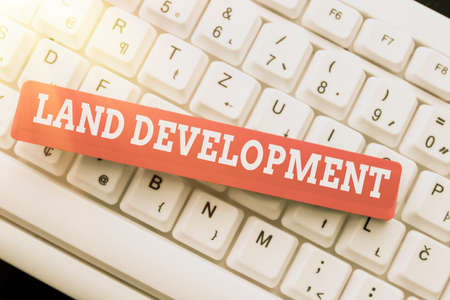Conceptual caption Land Development. Business showcase process of acquiring land for constructing infrastructures Typing Program Code Script, Abstract Downloading New Online Journal Banque d'images