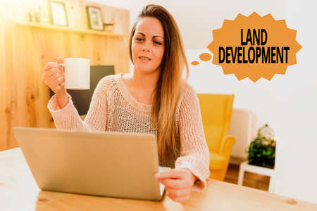 Text showing inspiration Land Development. Conceptual photo process of acquiring land for constructing infrastructures Browsing And Chatting In Social Media, Searching And Watching Videos