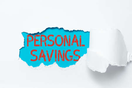 Conceptual display Personal Savings. Business concept money that a person keeps in an account in a bank or like Tear on sheet reveals background behind the front side Standard-Bild