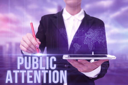 Conceptual caption Public Attention. Business concept the attention or focus of the general public to a person Lady In Uniform Standing Holding Tablet Typing Futuristic Technologies. Stock Photo