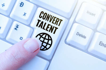 Text sign showing Convert Talent. Business showcase to bring over from one special natural ability or aptitude Lady finger showing-pressing keyboard keys-buttons for update