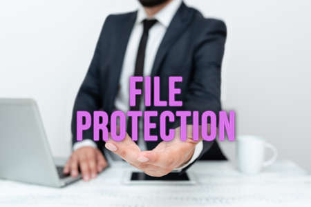 Handwriting text File Protection. Conceptual photo Preventing accidental erasing of data using storage medium Remote Office Work Online Smartphone Voice And Video Calling Stock Photo