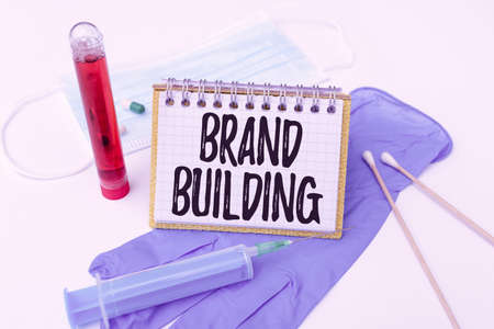 Text caption presenting Brand Building. Business concept activities associated with establishing and promoting a brand Preparing And Writing Prescription Medicine, Preventing Virus Spread
