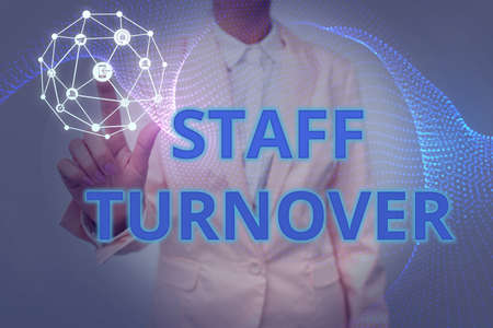 Hand writing sign Staff Turnover. Internet Concept The percentage of workers that replaced by new employees Lady In Uniform Holding Tablet In Hand Virtually Tapping Futuristic Tech. Stock Photo