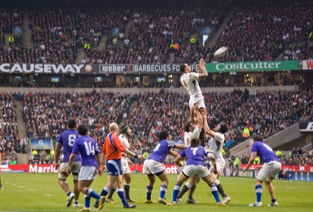 recieve: TWICKENHAM LONDON - NOVEMBER 20: England recieve lineout ball at England vs Samoa, England playing in white Win 26-13, at Investec Rugby Match on November 20, 2010 in Twickenham, England.