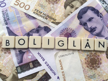 loaning: the word home loans on Norwegian bank notes Stock Photo