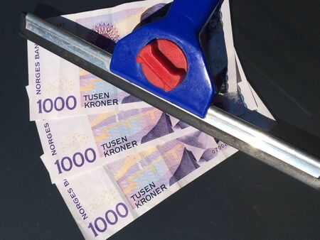 bank notes: norwegian bank notes below window cleaning tool