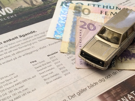 bank notes: volvo car on newspaper ad and swedish bank notes