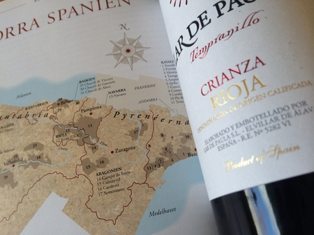 oenology: wine bottle on wine map