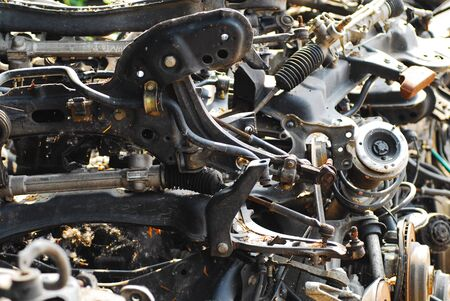 Old car parts left to rust in junkyard polluting the environment. No brand visible. Banque d'images - 137841459