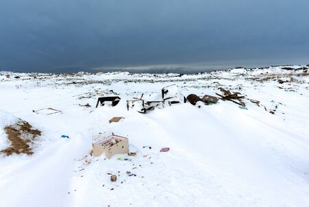 Illegal trash dump in the Arctic snow polluting the pristine environment