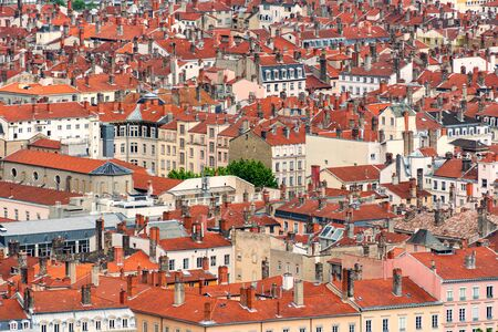 Red roofs and stone chimneys are the traditional architecture of the historic center of the French city of Lyon as well as many old European towns