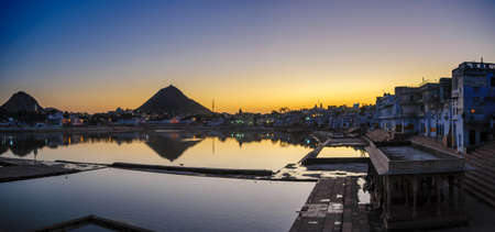 Sunset at Pushkar Lake, located in the town of Pushkar in Ajmer district of the Rajasthan state of western India. Pushkar Lake is a sacred lake of the Hindus.
