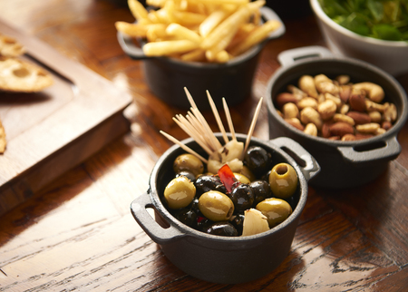 olives cocktail sticks in small bowl 스톡 콘텐츠