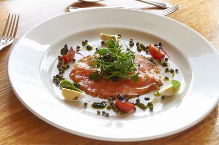 smoked salmon or gravlax on white plate