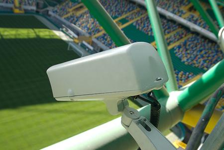 Security camera overlooking sports field football stadium 스톡 콘텐츠