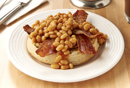 Baked beans and bacon on muffin crumpet