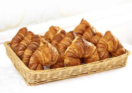 French fresh croissant in a basket 스톡 콘텐츠