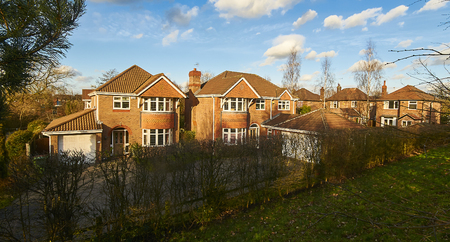 houses on housing estate behind hedges