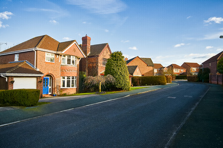 detached house in typical English housing estate blue sky