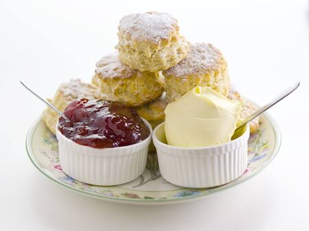 Scones cream and jam  on a plate Banco de Imagens